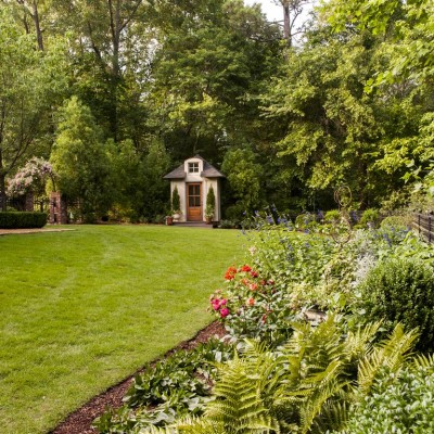 landscaped yard with designed with playhouse next to residence