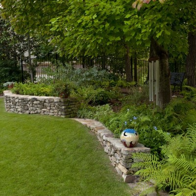 Stone wall and landscaped yard