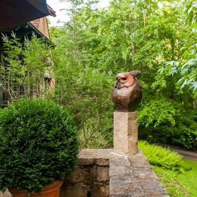 carved owl sculpture on veranda