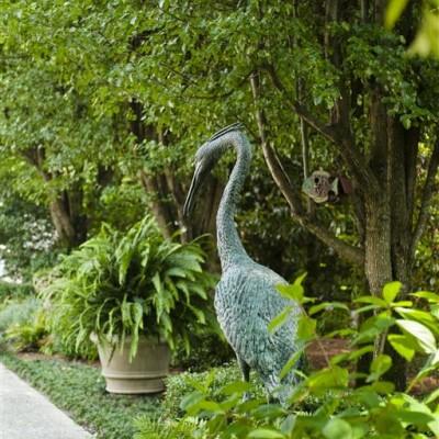 pelican sculpture in landscaped garden
