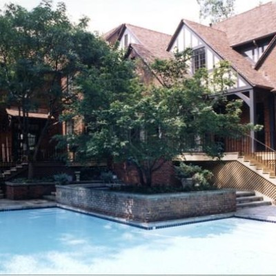 pool next to tudor style house