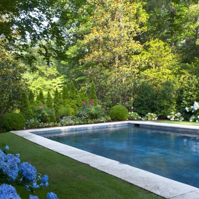 angled shot of pool surrounded by hydrangeas