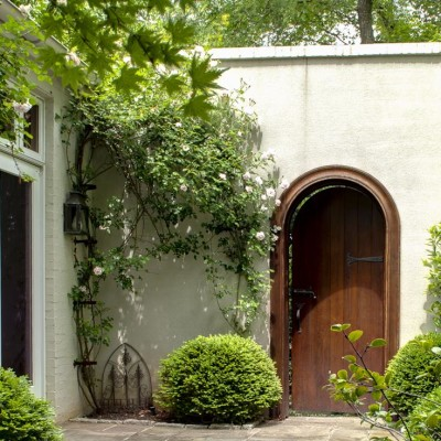 Roses in Courtyard with arched wooden door